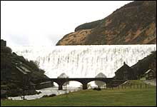 Water cascading down the overflow spillway of Caban Coch Dam