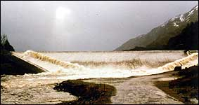 Floodwater passing over the spillway of Treig dam